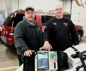 Trans Am Ambulance Services EMT Ken Moore and Paramedic Jay Prosser stock a 12-lead EKG cardiac monitor on its ambulance. The device is used to caption a patient's cardiac data on the scene and transmit the data in advance of the ambulance to the hospital for a seamless response and more immediate cardiac intervention in a catheterization lab.